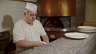 Man Cook Making Pizza In Italian Restaurant Kitchen Food Preparation video
