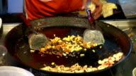 man cooking street food video