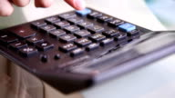 man counting on a calculator video