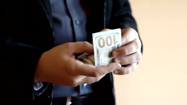 Man Counting One Hundred US Dollar Banknotes video