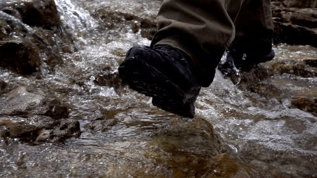 man crossing the creek, walks on the water video