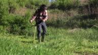man cutting grass video