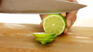 man cutting lime on chopping board video