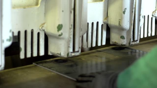 Man cutting steel plate on a shear video