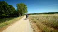 Man cycling on dirt track in France video