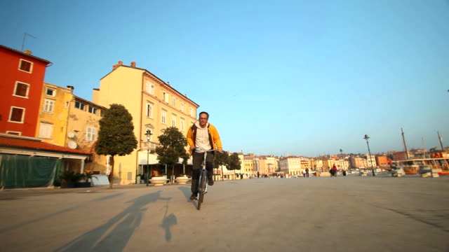 Man cycling on road in Rovinj video