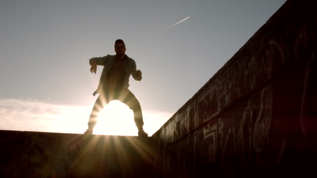 Man dancing in the city at dawn video