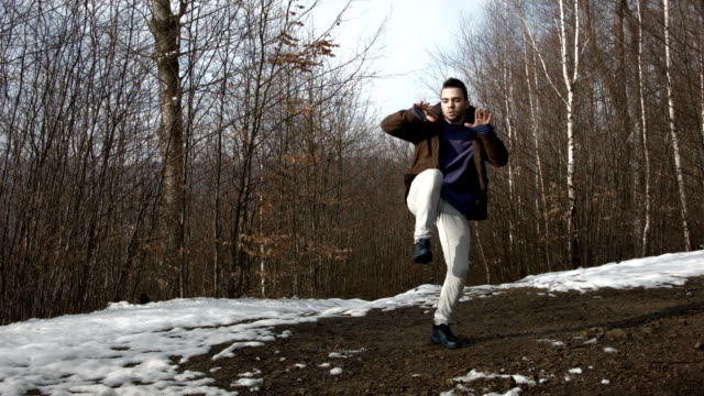 Man dancing in the mountains in spring season video