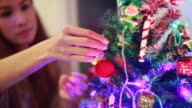 Man decorates the Christmas tree video