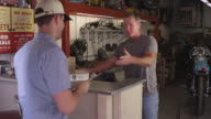 Man delivering boxes to mechanic video