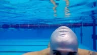 man  dives into pool swimming underwater video