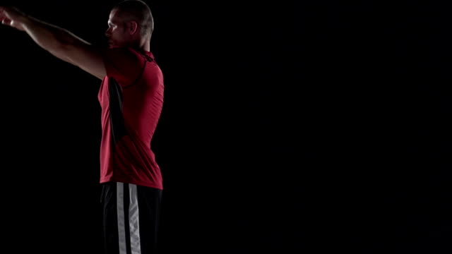 Man does backflip in slow motion, black background video