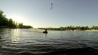 Man does extreme stunts on a wakeboard in slow motion on the lake video