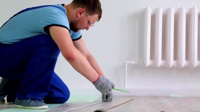 man doing a flooring renovation video