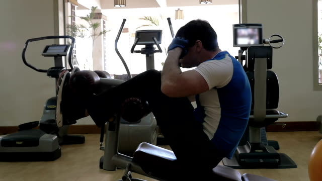 Man doing abs exercise in the gym video