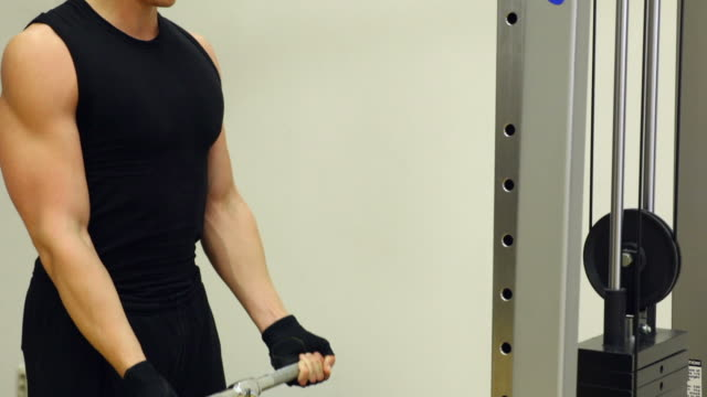 Man doing body building exercise at gym video