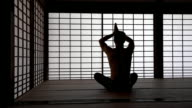 DS Man doing breathing exercises in tatami house video