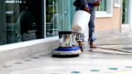 Man doing floor cleaning video