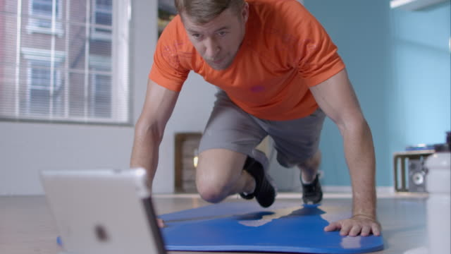 Man doing his workout at home video