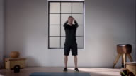 Man doing his workout in gym (arm circles) video