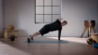 Man doing his workout in gym (pushup with rotation) video