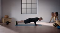 Man doing his workout in gym (pushup) video