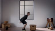 Man doing his workout in gym (squat straight jump) video