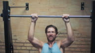 Man doing pull-ups in gym video