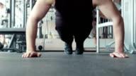 man doing pushups in gym video