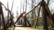 HD DOLLY: Man Doing Push-ups On A Footbridge video