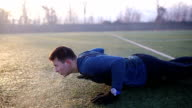 Man Doing Pushups outdoors on cold winter's day video
