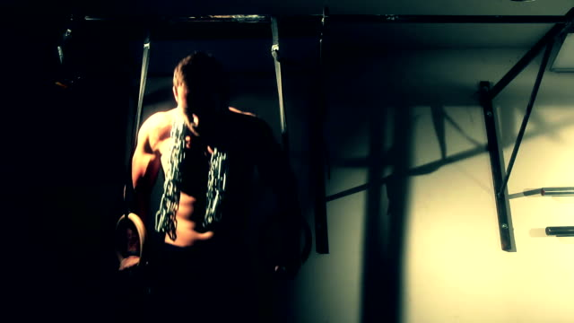 Man doing ring dips with chain video