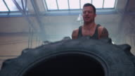Man doing workout with big tire video