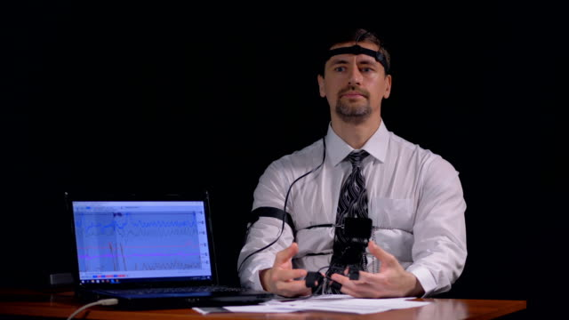 A man doubting and fidgeting when answering polygraph questions. video