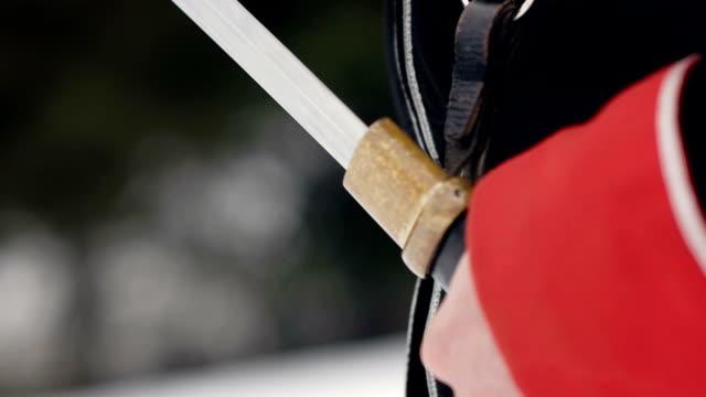 Man draws his sword . Close up. video