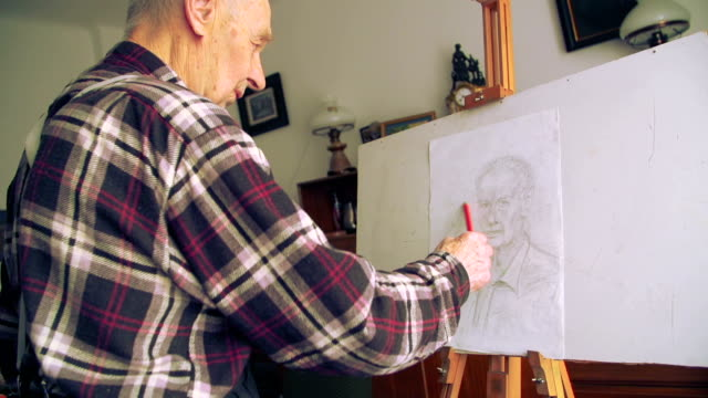 Man draws Self Portrait video