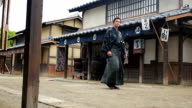 Man Dressed in Traditional Costume in an Edo Era Japanese Village video