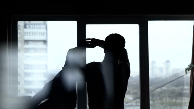 Man Dressed Suit Near The Window video
