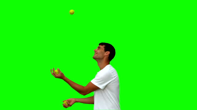 Man dribbling with balls on green screen video