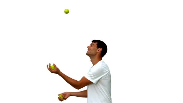 Man dribbling with balls on white screen video