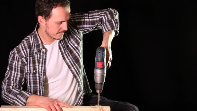 Man drills wood video
