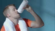 Man drinking after sport video