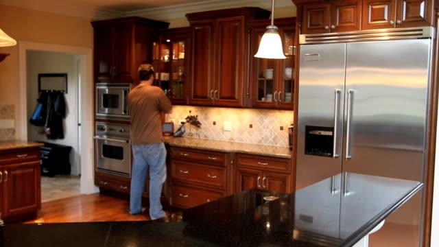 Man Drinking Water in Kitchen video
