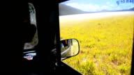HD MS: Man drive a car on desert volcano video