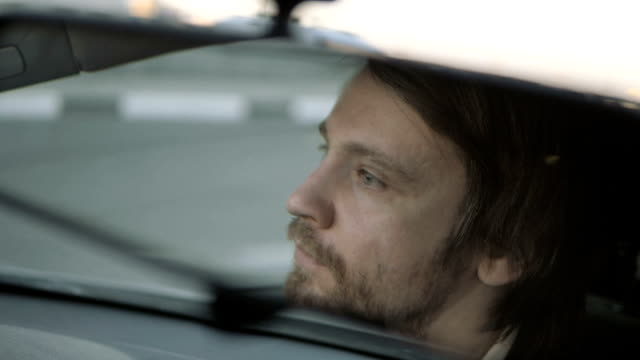 Man Drives a Car And Looks In The Rear-View Mirror video