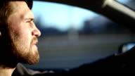 Man drives a car at sunset video