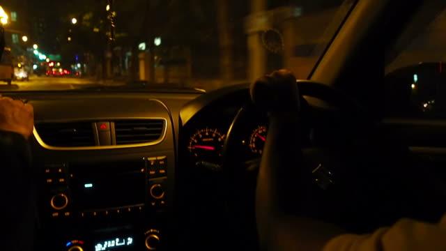 A man driving a car at night video