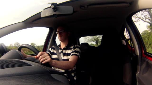 Man driving a car video