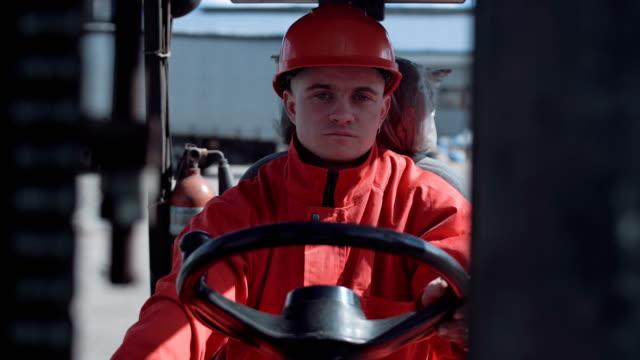 Man driving a loading car video