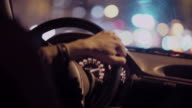 Man driving a private taxi through city streets at night video